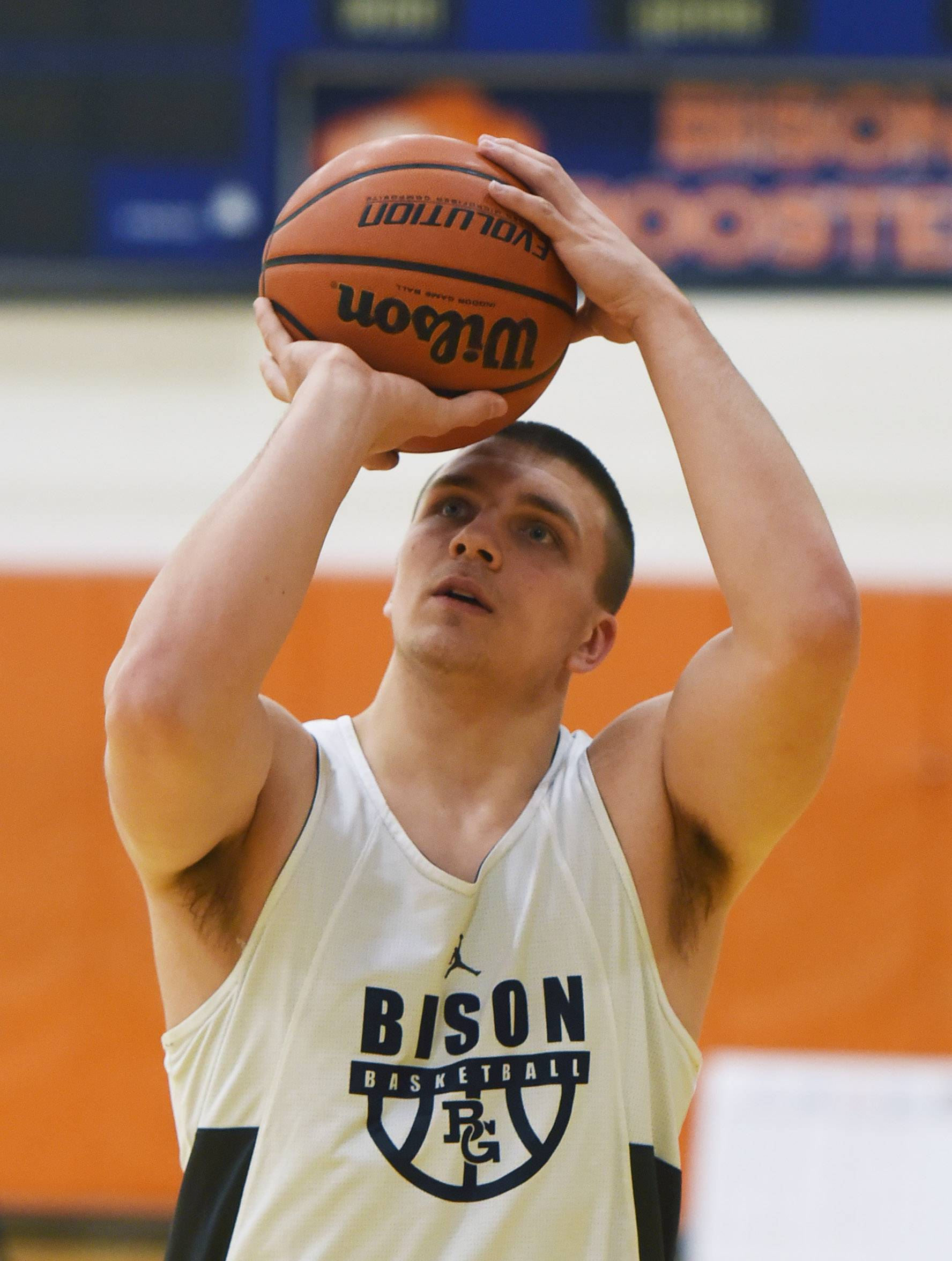 Buffalo Grove boys basketball player Tom Trieb participates in a shooting drill during practice.