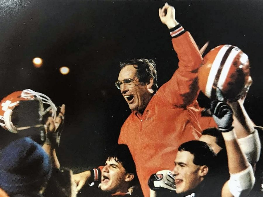 Former Hersey football coach Bruce Glover celebrates the Huskies' 1987 Class 5A state football championship. Glover, who coached at Hersey for 19 years, passed away recently in California.