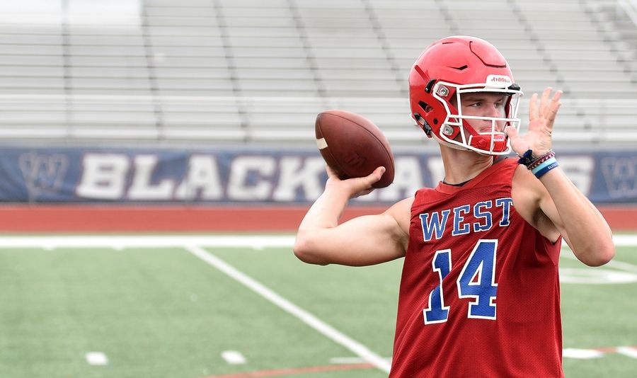 Quarterback Will Tamara rears back to pass during the first day of football practice at West Aurora High School Monday.
