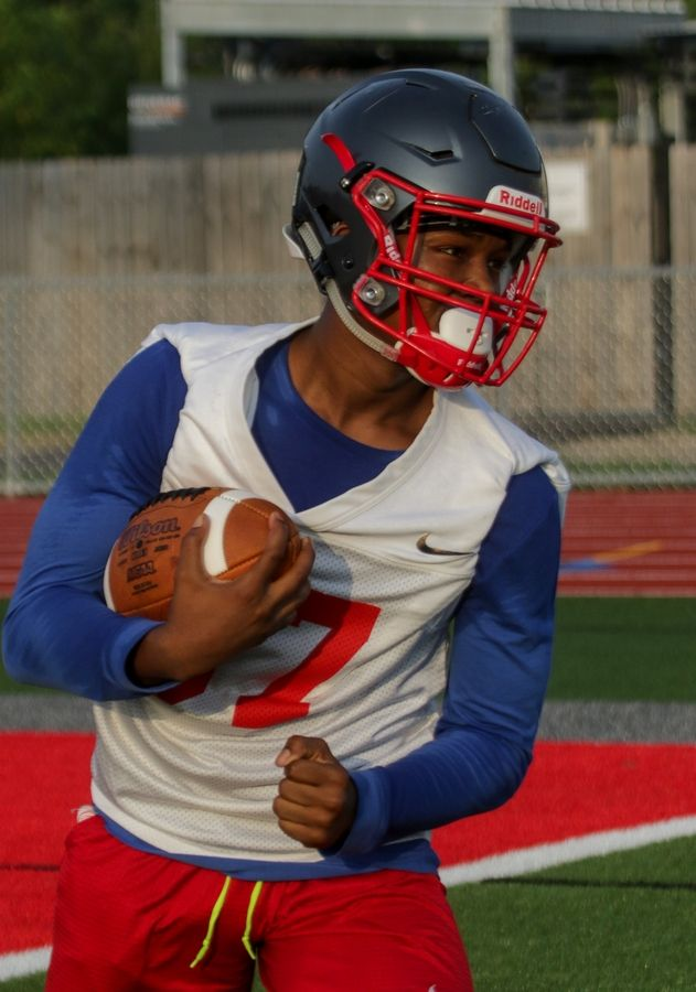 Ronald Todd with the ball during Palatine High School football practice on Monday.
