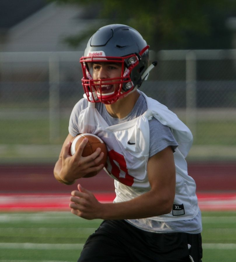 Luke Popovic with the ball during Palatine High School football practice on Monday.