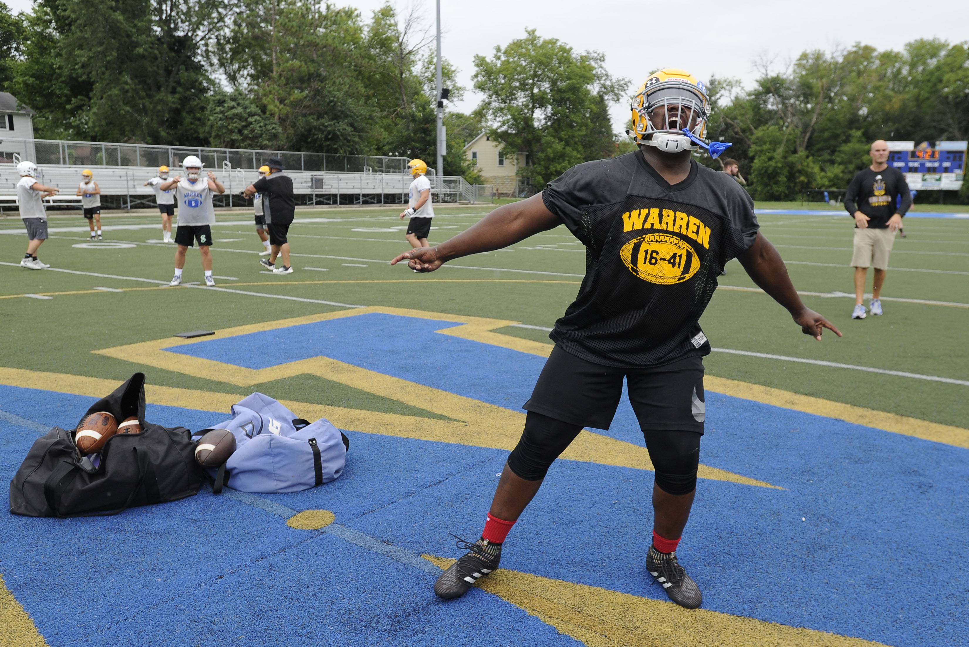 Images: First day of high school football practice in the suburbs