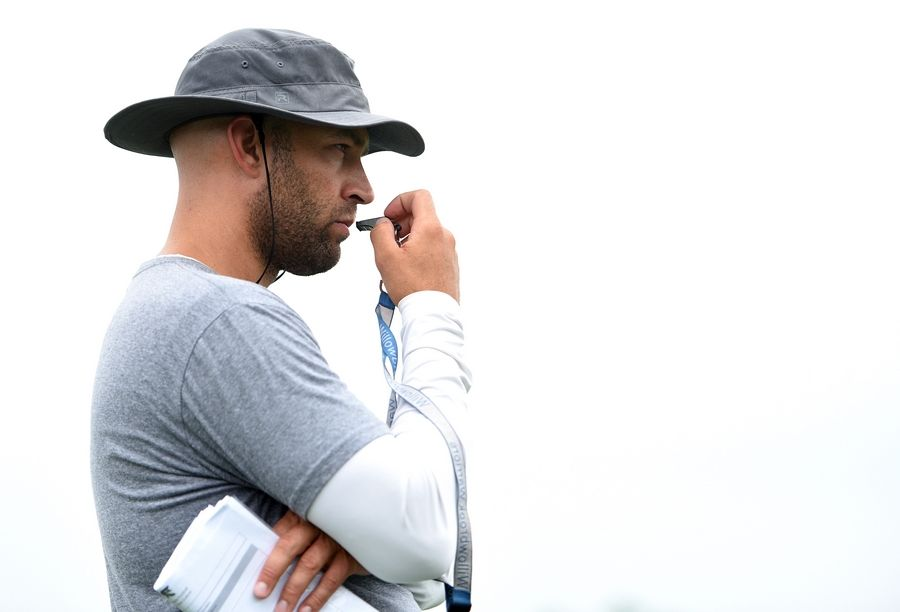 Head coach Nick Hildreth watches the action during the  first day of football practice at Willowbrook High School in Villa Park Monday.