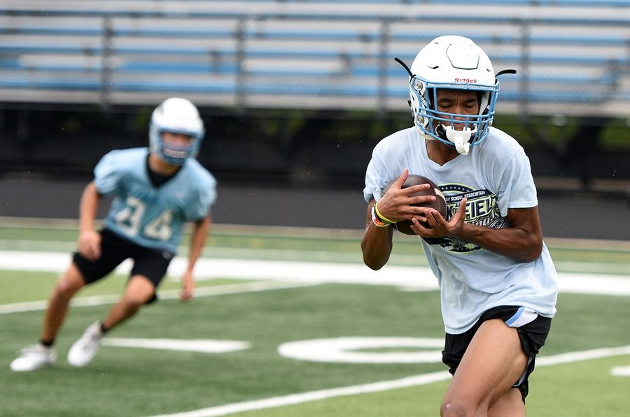 Deandre Holiday hauls in a catch during the first day of football practice at Willowbrook High School in Villa Park Monday.