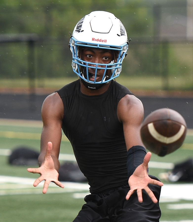 Haven Pryor keeps his eyes on the ball as brings in a catch during the first day of football practice at Willowbrook High School in Villa Park Monday.