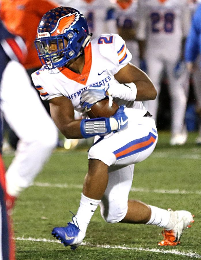 Hoffman Estates' Max Lock carries the ball against Conant last year. Lock should be a mainstay in the Hawks' backfield again this season.