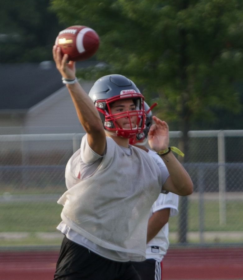 Quarterback Joe Ayala passes during Palatine High School football practice. Ayala and the Pirates hope to improve on last year's 1-8 record.