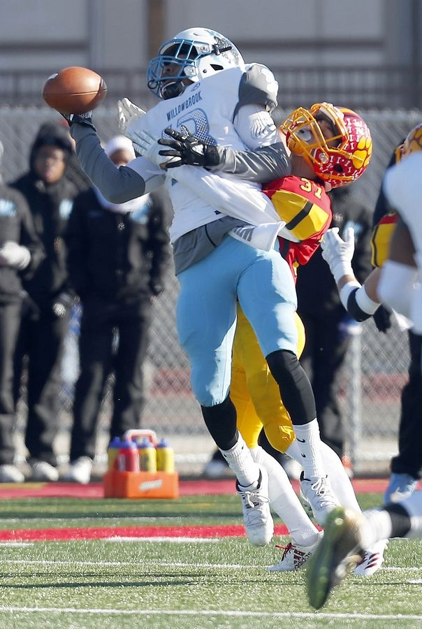 Willowbrook's Everett Stubblefield (13) and Batavia's Evan Kopf (37) battle for the ball last season during playoff football.