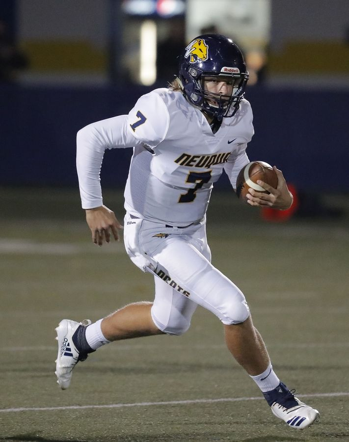Neuqua Valley's Mark Gronowski runs with the ball during the first-round of the Class 8A football playoffs last season in Gurnee.