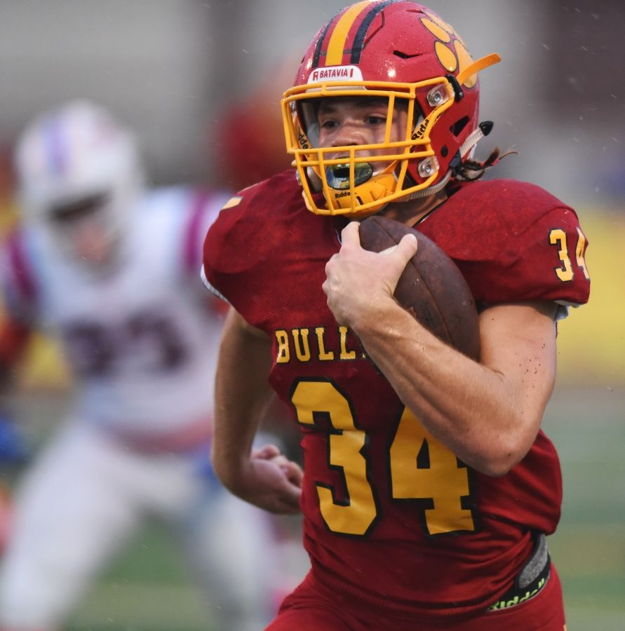 Batavia's Quinn Urwiler carries the ball for a touchdown against East St. Louis during the second quarter of Saturday's game in Batavia.