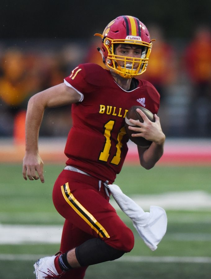 Batavia quarterback Kyle Oroni carries during Saturday's game against East St. Louis.