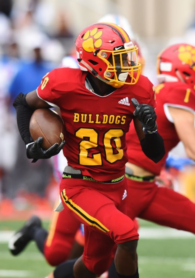 Batavia's Brandon Vines carries the ball during Saturday's game against East St. Louis.