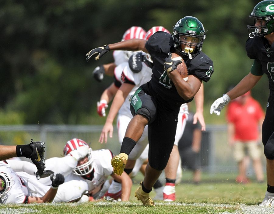 Glenbard West's Joey Richmond  makes a move that clears him for along touchdown run against Maine South in a football game in Glen Ellyn Saturday, August 31, 2019.