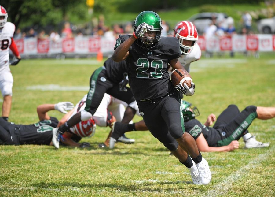 Glenbard West's Jaylen Moore sprints up the sidelines for a long touchdown run against Maine South in a football game in Glen Ellyn Saturday, August 31, 2019.