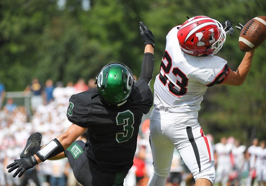 Glenbard West's Gerik Tyburk breaks up a pass to Maine South's Daniel Lazic in a football game in Glen Ellyn Saturday, August 31, 2019.