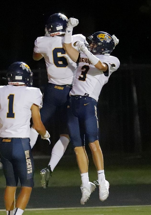 Neuqua Valley's Sean Larkin, left, and Garrett Stare celebrate after a touchdown during their game Friday in Lincolnshire.
