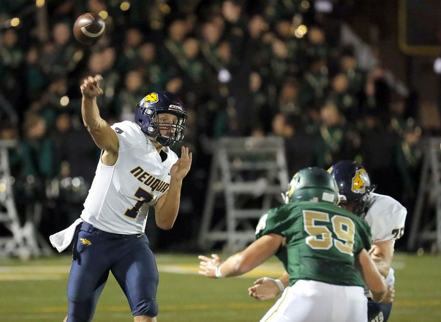 Neuqua Valley's Mark Gronowski, left, throws during their game Friday in Lincolnshire.