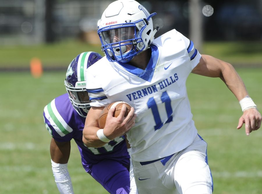 Vernon Hills' Ryan Mann is unstoppable on offense against Waukegan in the first quarter of the varsity football matchup in Waukegan on Saturday.