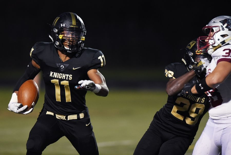 Grayslake North's Tony Hines II carries the ball during Friday's game against Antioch.