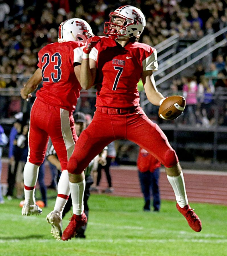 South Elgin's Calin Gurau, right, celebrates his first-quarter touchdown against Elgin with teammate Samuel Robles at South Elgin Friday night.