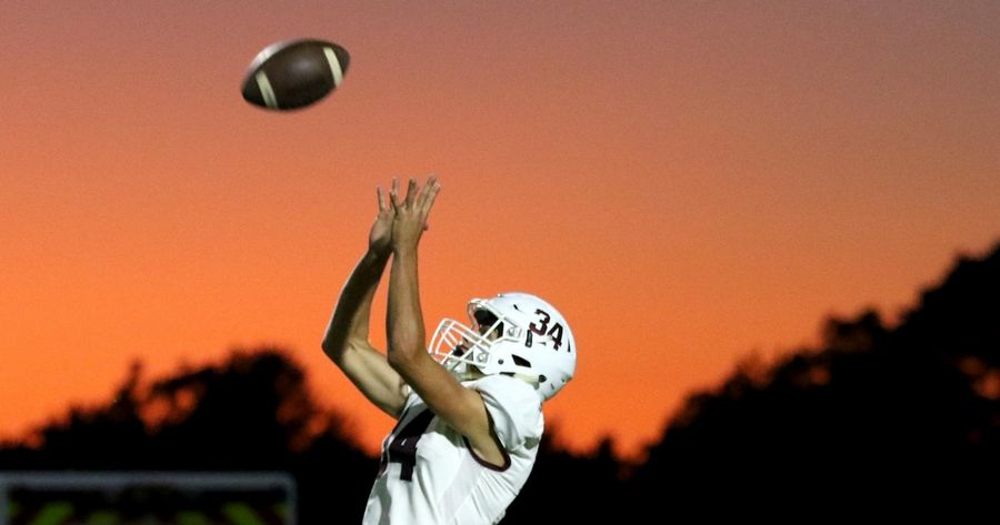 Elgin's Alexander West returns a kickoff during varsity football at South Elgin Friday night.