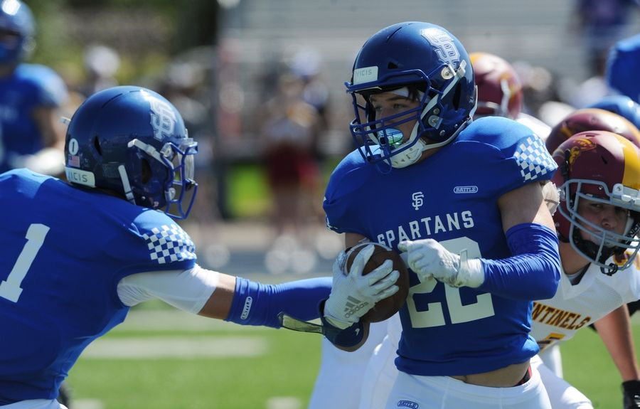 St. Francis' Ben Radel shakes off Westmont's defense enroute to his first quarter touchdown in the varsity football matchup held at Wheaton College McCully Stadium on Saturday.