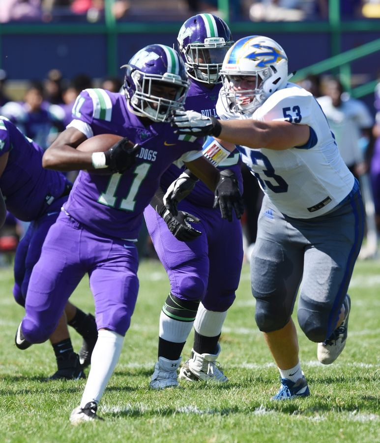 Waukegan's Latrell Brown gets tackled by Warren's Tommy Matheson during Saturday's game in Waukegan.