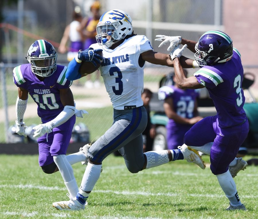 Warren's Derrick McLaughlin carries the ball during Saturday's game in Waukegan.