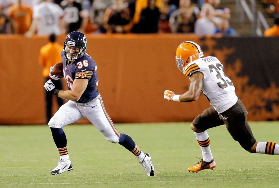 Bears running back Jordan Lynch runs away from cornerback Jordan Poyer in the fourth quarter of an August 2014 preseason game in Cleveland.