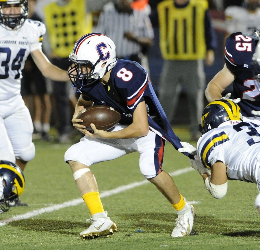 Mark Welsh/mwelsh@dailyherald.comSophomore quarterback Guiseppe Dugo (8) will lead Conant into battle Friday night at New Trier.