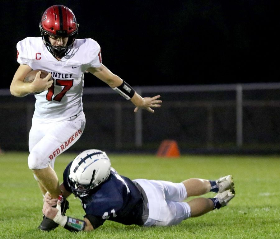 Cary-Grove's Jake Johnson catches Huntley's Bruno Bosman in varsity football at Al Bohrer Field on the campus of Cary-Grove High School Friday night.
