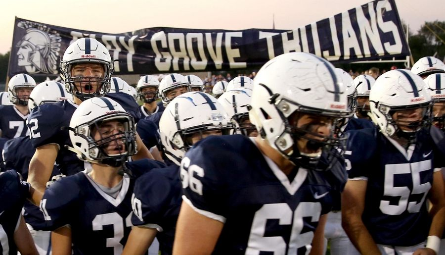 Cary-Grove's Trojans get revved up before facing Huntley in varsity football at Al Bohrer Field on the campus of Cary-Grove High School Friday night.
