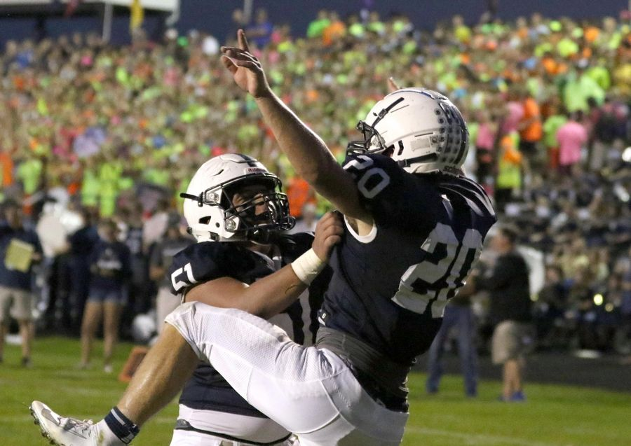 Cary-Grove's Blake Skol, right, celebrates his first-quarter touchdown with Nathan Gamez against Huntley in varsity football at Al Bohrer Field on the campus of Cary-Grove High School Friday night.