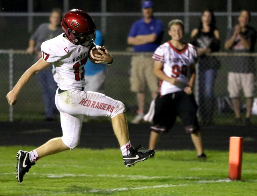 Huntley's Bruno Bosman sprints in with a first-quarter touchdown against Cary-Grove in varsity football at Al Bohrer Field on the campus of Cary-Grove High School Friday night.