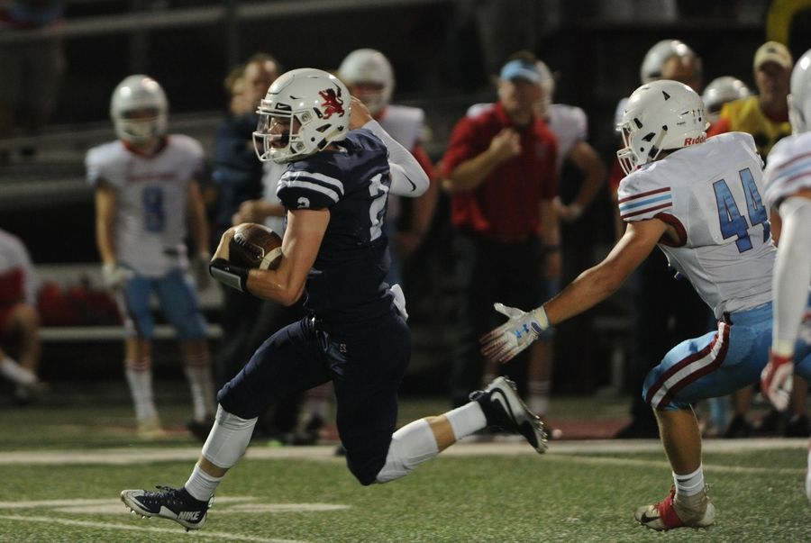 St. Viator's Jack Mahoney carries in the first quarter against Marian Central last week. The Lions travel to Montini Friday night.
