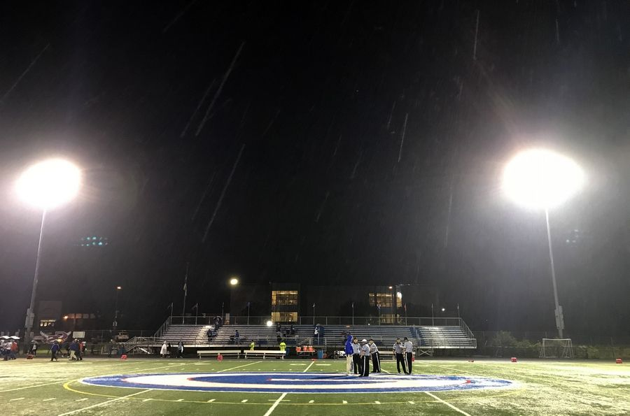 Empty bleachers at the Glenbard South stadium as lightning forced the fans to seek shelter with 35 seconds before the end of the second quarter in the varsity matchup of Larkin and Glenbard South on Friday.