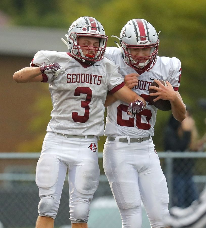 Antioch's Gavin Calabrese, left, and Andrew Bowles celebrate after a touchdown during their game on Friday in Fox Lake.