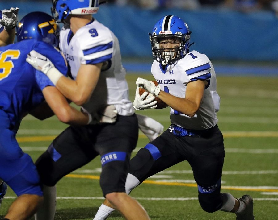Lake Zurich's Thomas Vages (1) looks for an opening during the Bears' game at Lake Forest last Friday night.