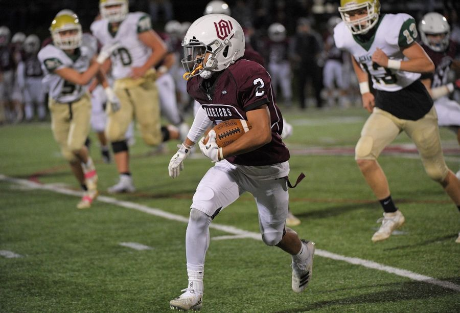 Wheaton Academy's Alex Ventimilla makes a long gain against Bishop McNamara in a football game in West Chicago Thursday.