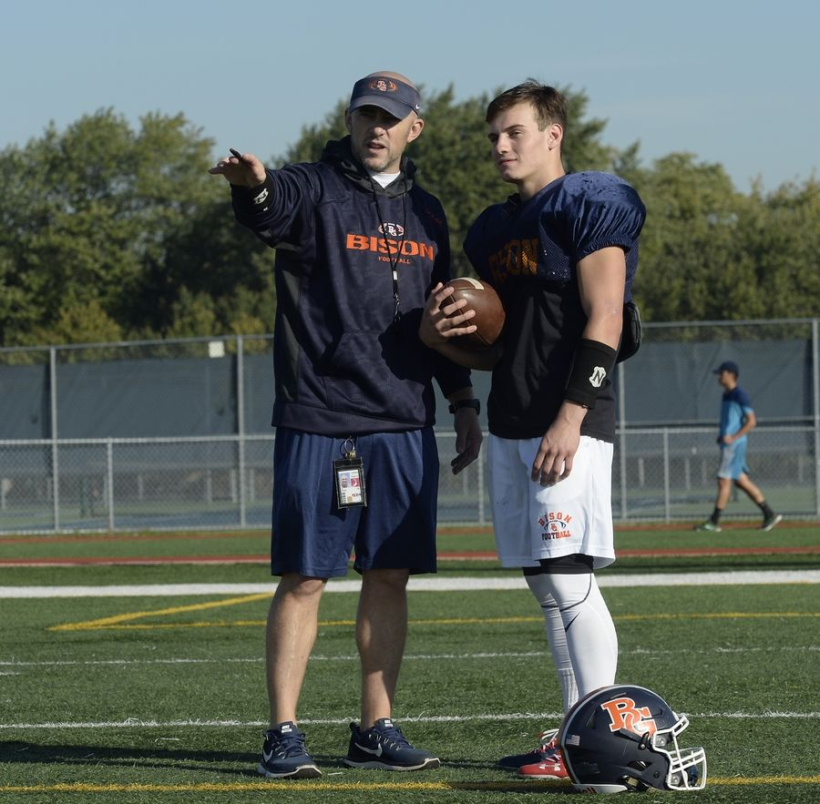 Buffalo Grove head football coach Jeff Vlk with senior Max Oberman on a play during practice for their upcoming showdown against 6-0 Hersey this Friday.