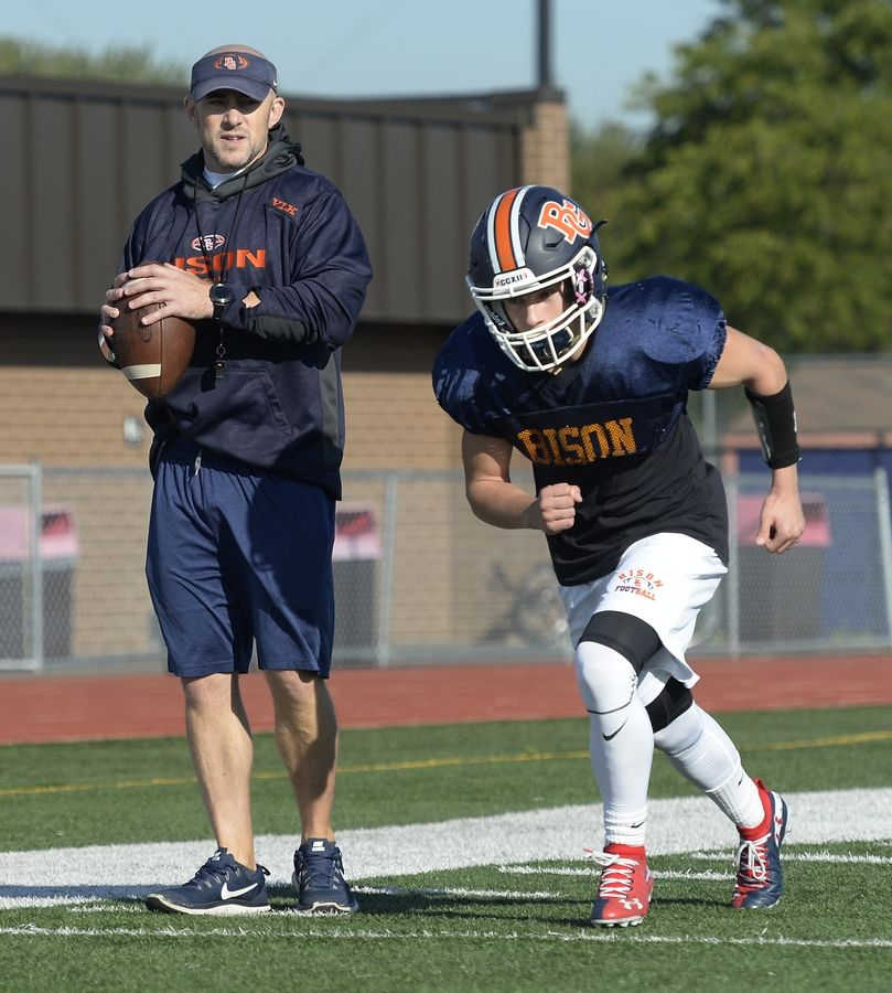 Buffalo Grove head football coach Jeff Vlk works with senior Max Oberman on a pass play during practice for their upcoming showdown against 6-0 Hersey this Friday.