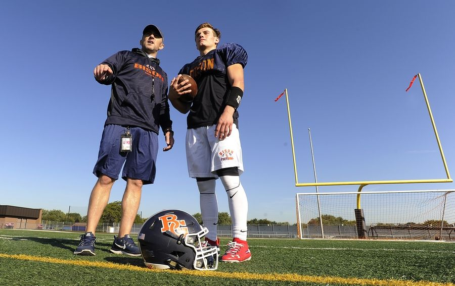 Buffalo Grove head football coach Jeff Vlk with senior Max Oberman during practice for their upcoming showdown against 6-0 Hersey this Friday.