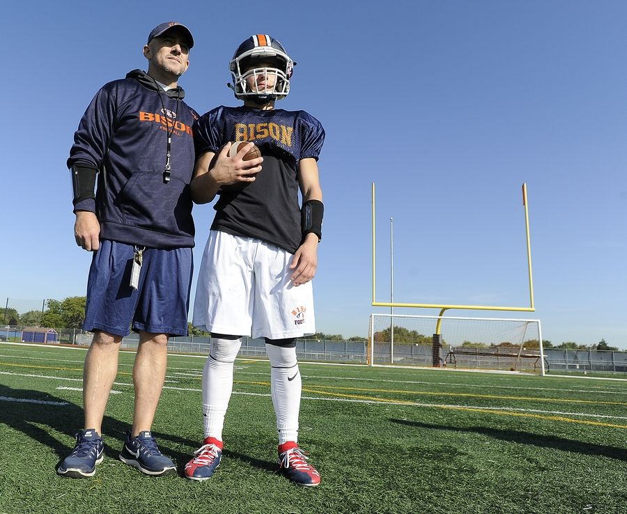 Buffalo Grove's head football coach Jeff Vlk with senior Max Oberman during practice for their upcoming showdown against 6-0 Hersey this Friday.