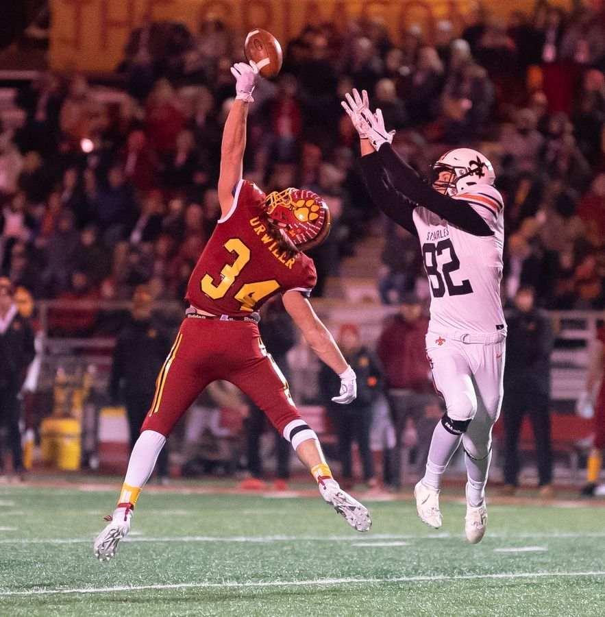 Batavia's Quinn Urwiler (34) deflects a pass intended for St. Charles East's Matthew Sastre (82) at Batavia High School in Batavia, IL on Friday, October 11, 2019