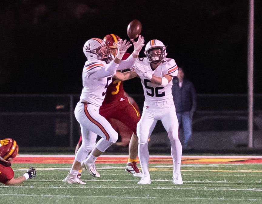 St. Charles East's Logan Flesch (51) deflects a pass for an interception against Batavia at Batavia High School in Batavia, IL on Friday, October 11, 2019