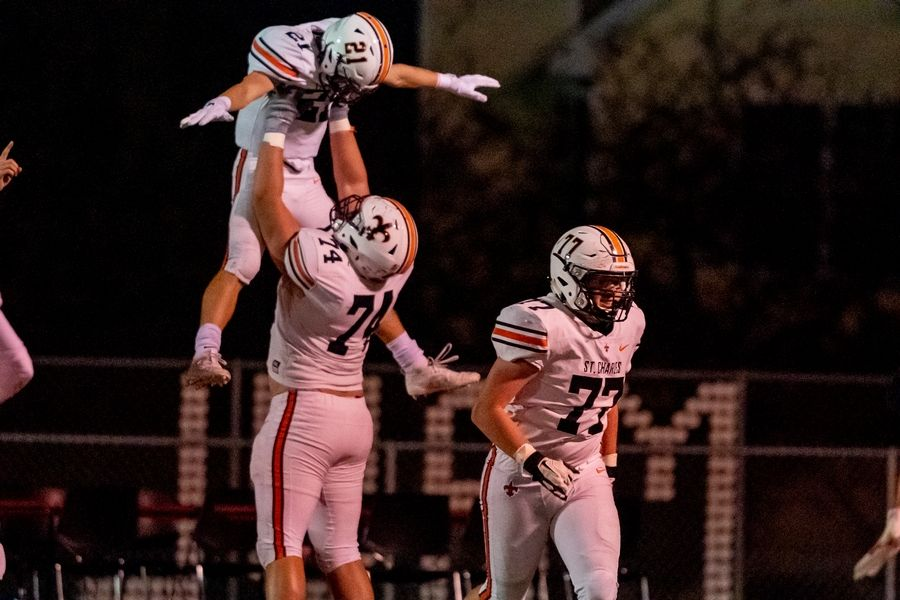 St. Charles East's Colton Conn (21) celebrates his touchdown run with Dylan Barrett (74) at Batavia High School in Batavia, IL on Friday, October 11, 2019