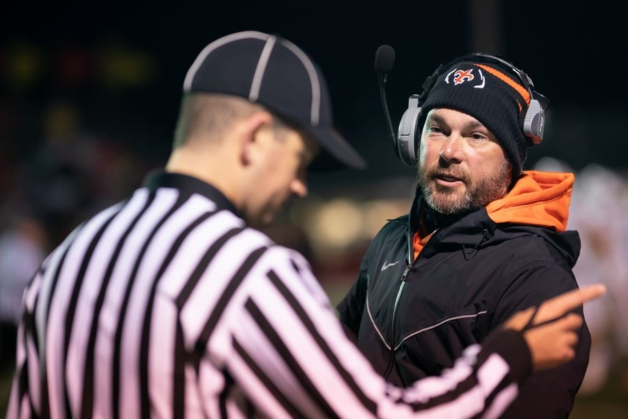 St. Charles East's head coach Bryce Farquhar talks to an official during a break in play against Batavia at Batavia High School in Batavia, IL on Friday, October 11, 2019