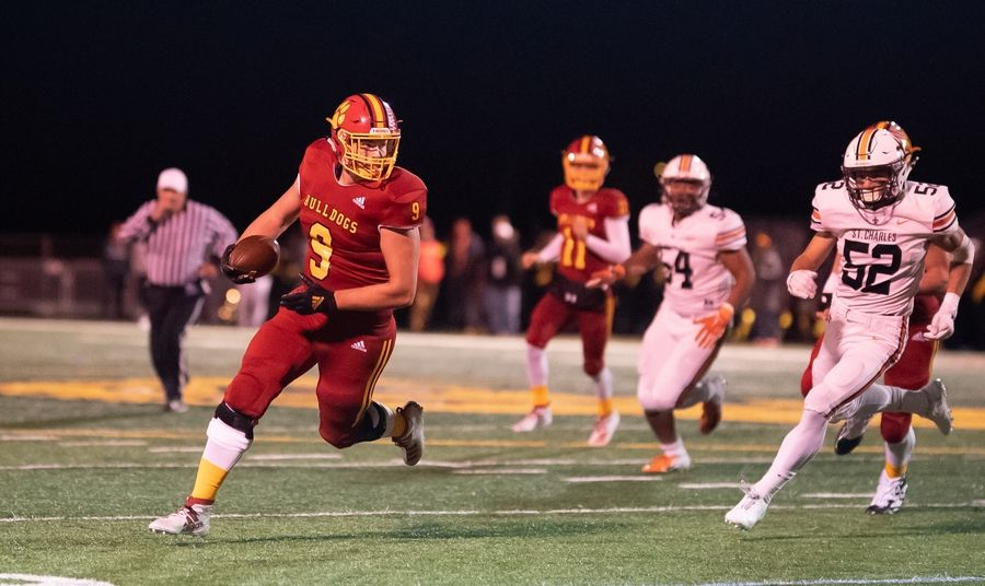 Batavia's Jack Valente (9) runs after the catch against St. Charles East at Batavia High School in Batavia, IL on Friday, October 11, 2019