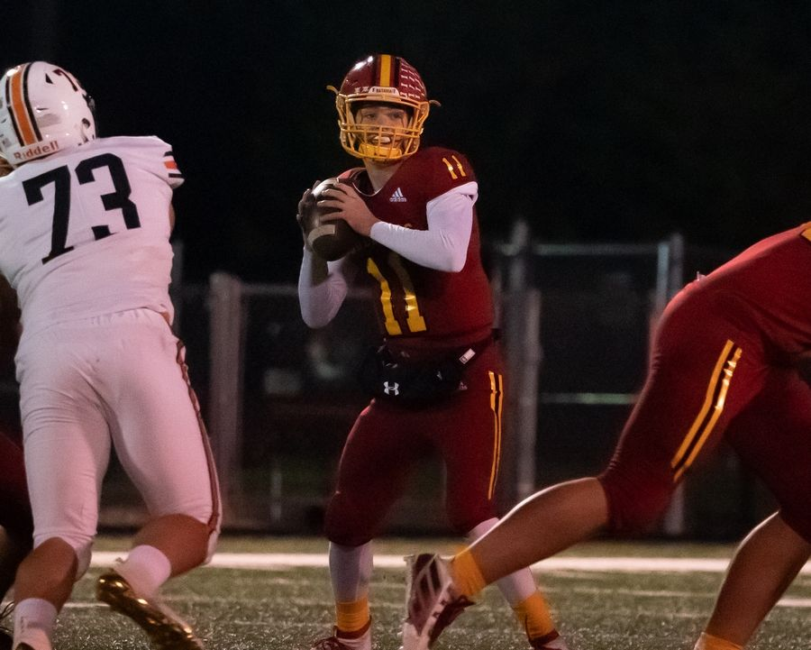 Batavia's Kyle Oroni (11) sits in the pocket and looks downfield against St. Charles East at Batavia High School in Batavia, IL on Friday, October 11, 2019