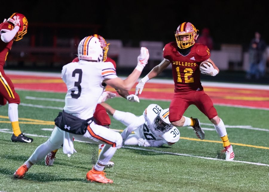 Batavia's Sam Barus (12) carries the ball against St. Charles East at Batavia High School in Batavia, IL on Friday, October 11, 2019